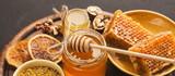 Various types of honey on wooden platter, closeup - 202788682