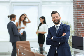 businessman on the background of the workplace