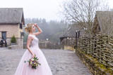 wedding photo session of the bride in the nature - 202816046