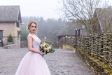 wedding photo session of the bride in the nature - 202816083