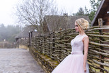wedding photo session of the bride in the nature - 202816820