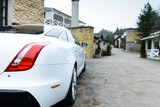 white car in a European village - 202817656