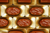 chocolate candies in a gold gift box
