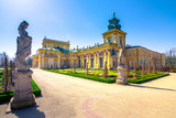 The royal Wilanow Palace in Warsaw, Poland, with gardens, statues and river around it. - 202831479
