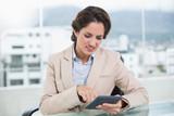 Upset businesswoman using calculator - 202840857