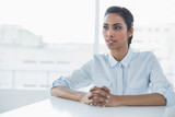 Content calm businesswoman sitting at her desk - 202843268