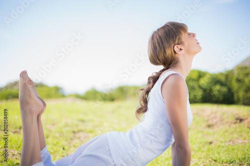 Fototapeta Natural young woman stretching