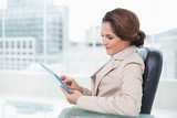 Content businesswoman looking at tablet - 202858820