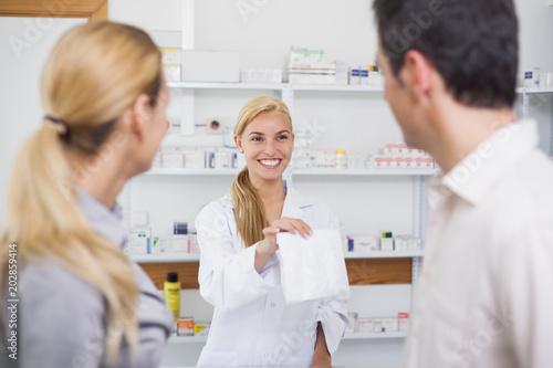 Fotobehang Apotheek Pharmacist giving a drug bag to patients