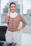 Smiling classy businesswoman on the phone - 202860200