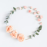 Fototapety Flowers composition. Wreath made of rose flowers, eucalyptus branches on pastel gray background. Flat lay, top view, copy space, square