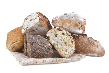 group of different variety of bread on white background