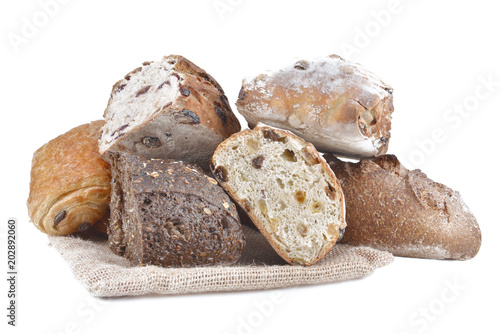 Fototapeta group of different variety of bread on white background