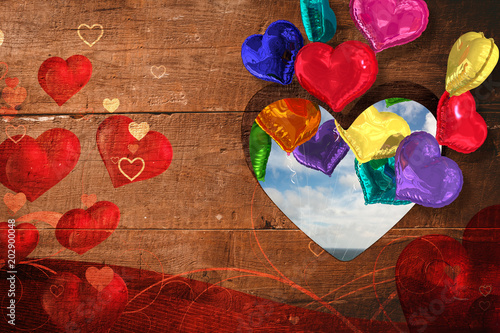 Fotobehang Rood paars Valentines heart design against blue sky with white clouds