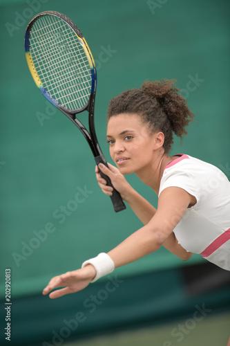 Fotobehang Tennis tennis female player hitting ball with forehand