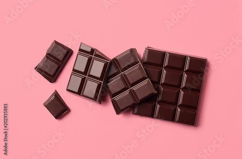 Dark chocolate on pink background - 202935883