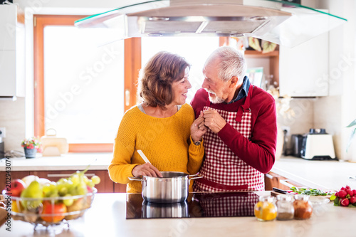 Happy senior couple cooking in the kitchen. - 202943074