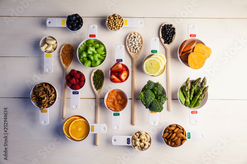 Poster Portion cups and spoons of healthy ingredients