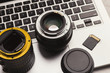 Photo camera lenses and memory card on computer