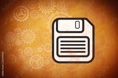 floppy disk against orange background