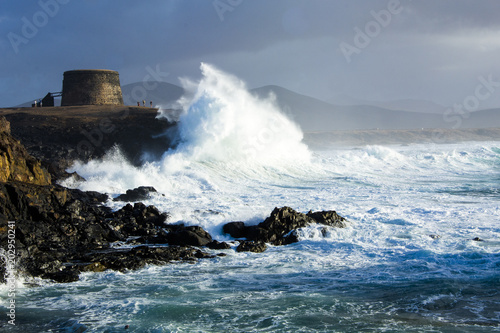Fotobehang Canarische Eilanden wave breaking on the coast, Fuerteventura Canary Islands