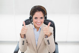 Smiling businesswoman showing thumbs up - 202961263