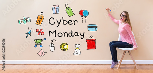 Cyber Monday with young woman holding a pen in a chair