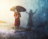 Woman in rain storm with shadow - 202967273