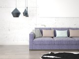 Mock up a bright living room with a gray sofa and a fashionable background.