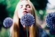 Woman blowing flower
