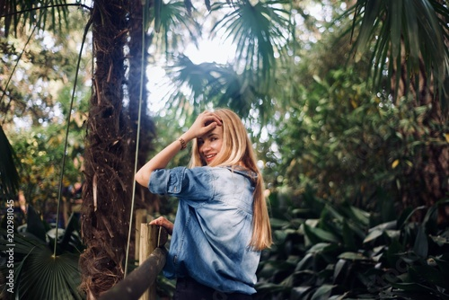 Girl tourist walking in the tropical forest - 202981045