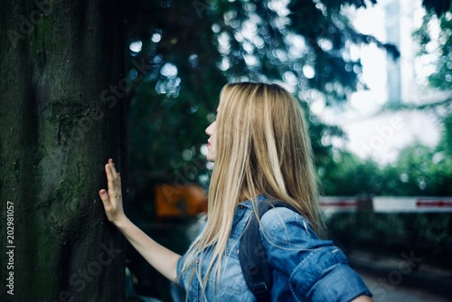 Girl tourist walking in the tropical forest - 202981057