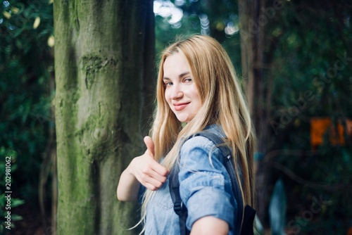Girl tourist walking in the tropical forest - 202981062
