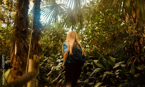 Girl tourist walking in the tropical forest - 202981072