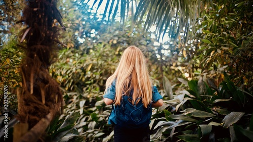 Girl tourist walking in the tropical forest - 202981078