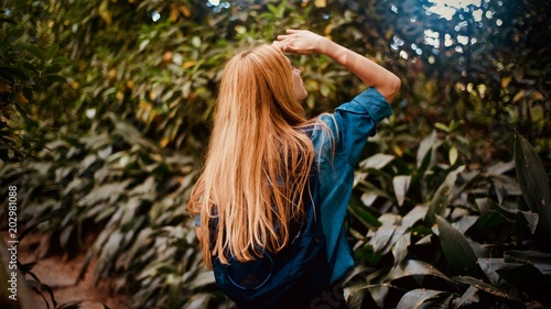 Girl tourist walking in the tropical forest - 202981088