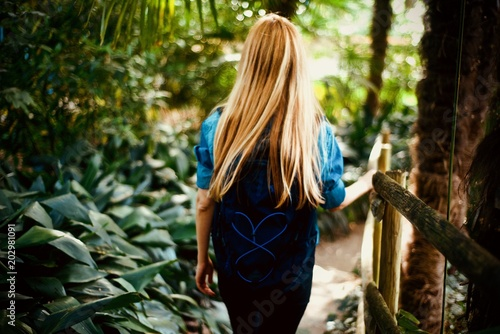 Girl tourist walking in the tropical forest - 202981091