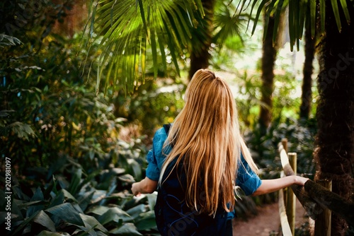 Girl tourist walking in the tropical forest - 202981097
