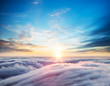 Beautiful sunset sky above clouds - 202981454
