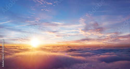 Beautiful sunset sky above clouds - 202981439
