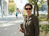 Woman wearing a jacket, outdoor portrait on street