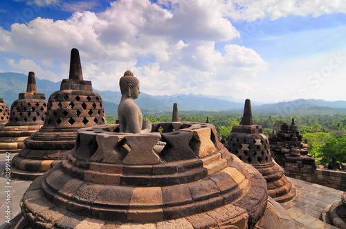 Plexiglas Boeddha Stupas and Statue of Buddha at Borobudur Temple, Yogjakarta Indonesia.
