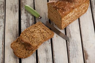 Sliced bread loaf with knife