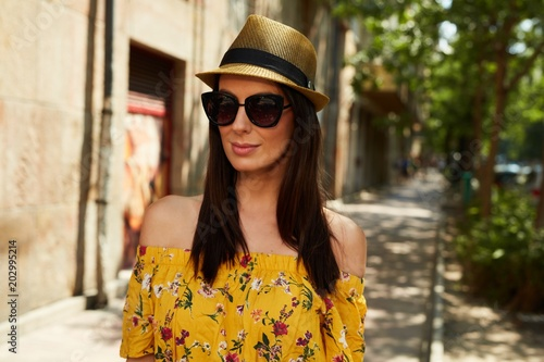 Happy young woman on the street outdoor in summer