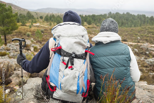 Fotobehang Donkergrijs Couple with backpack and trekking pole on a hike