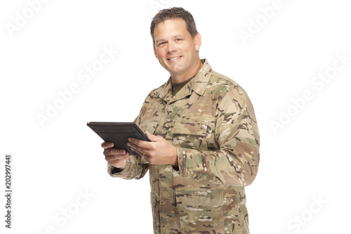 U.S. Army Soldier, Sergeant. Isolated with digital tablet.