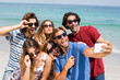 Young friends taking selfie at beach