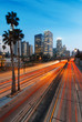 Quadro City of Los Angeles California at sunset with light trails