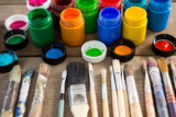 Various paintbrush and watercolors on wooden surface - 203026455