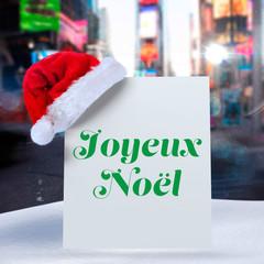 Joyeux noel against blurry new york street © vectorfusionart